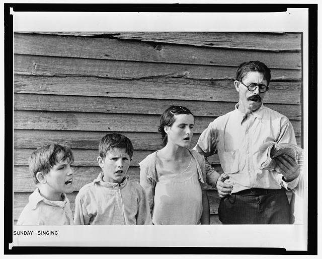 Frank_Tengle,_an_Alabama_sharecropper,_and_family_singing_hymns