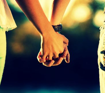 teenager-boy-and-girl-friends-holding-hands
